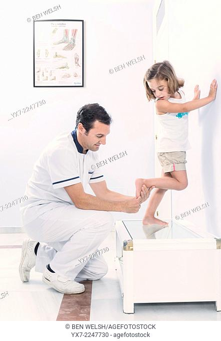Podologist treating a young girl