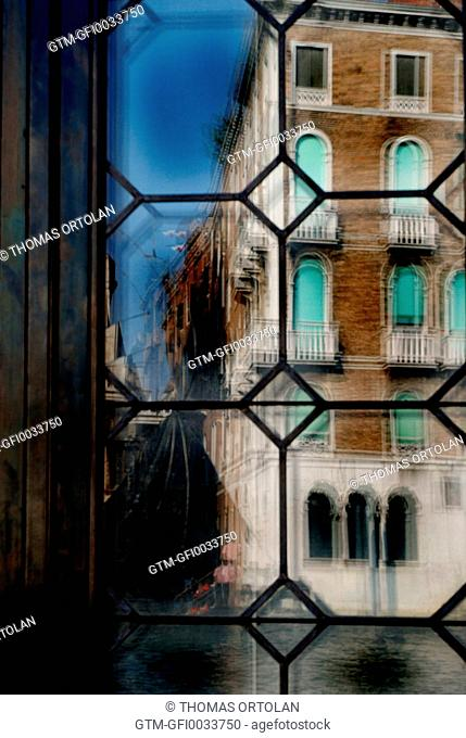 Distorted view of an old Venetian building through glass