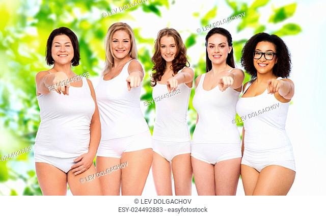 choice, friendship, beauty, body positive and people concept - group of happy different women in white underwear pointing finger on you over green natural...