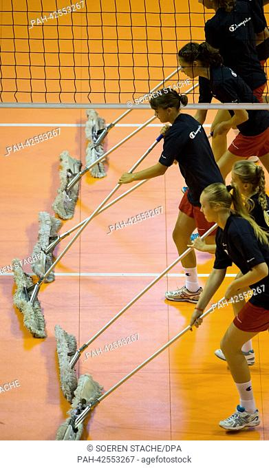 Young girls clean the floor during the women's CEV Volleyball European Championship bronze medal match between Belgium and Serbia at Max-Schmeling-Hall in...