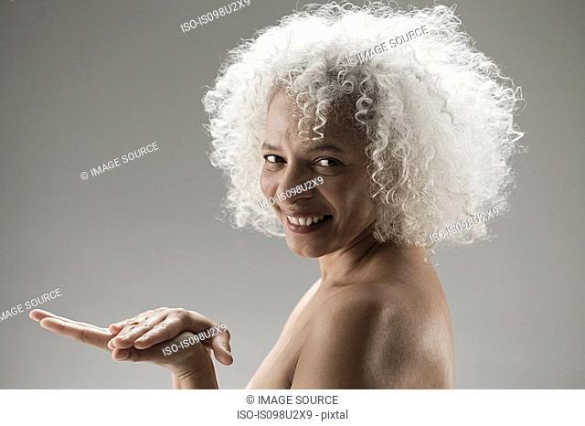 Mature woman touching palm of hand