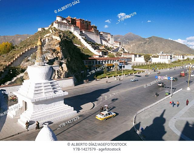 Traffic on the streets of Lhasa with the Potala