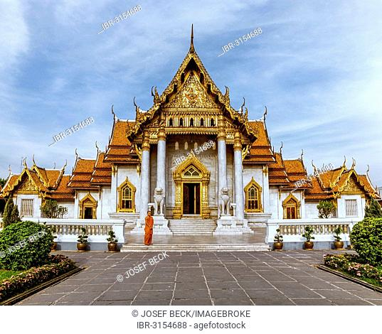 Wat Benchamabopit, temple made of Carrara marble, monk in front of the ubosot, temple in the Dusit district