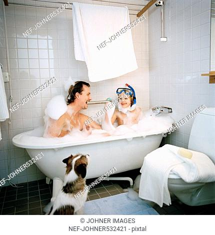 Scandinavian father and son taking a bath together, Hammarby sjostad, Sweden