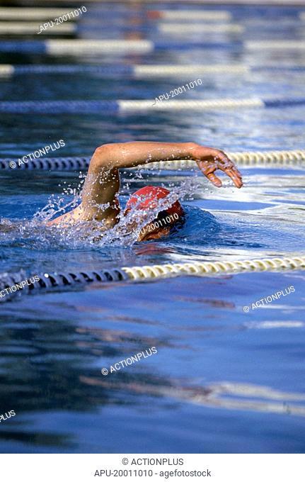 Man swimming front crawl in pool
