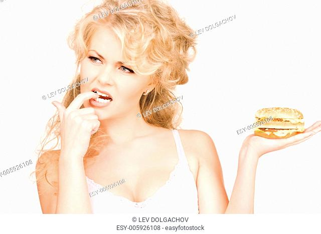 young beautiful woman with burger over white