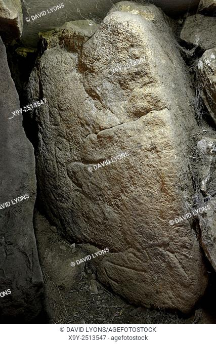 Early Neolithic tumulus of Grah-Niol at Arzon, Brittany, France. One of the carved stones inside the burial chamber