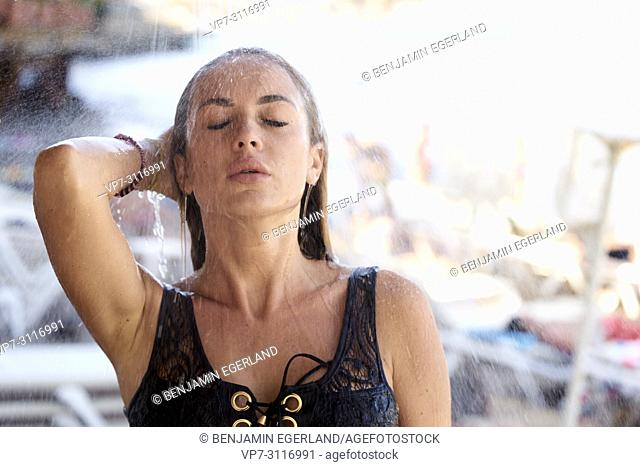 Portrait of young attractive woman in holiday destination Chersonissos, Crete, Greece