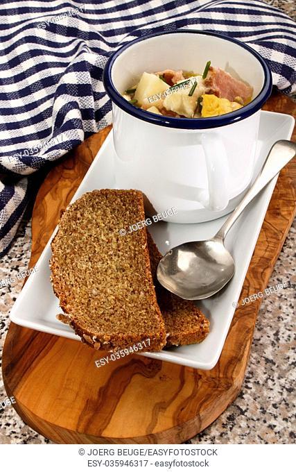 irish fish chowder in a mug with bread on a plate