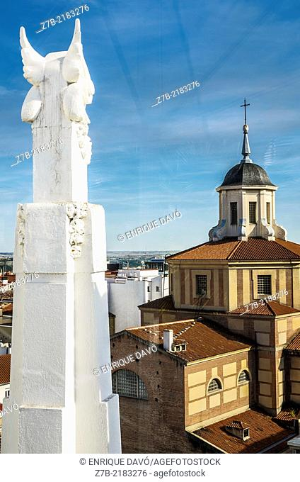 View of a white sculpture in a roof building in the center of Madrid city, Spain