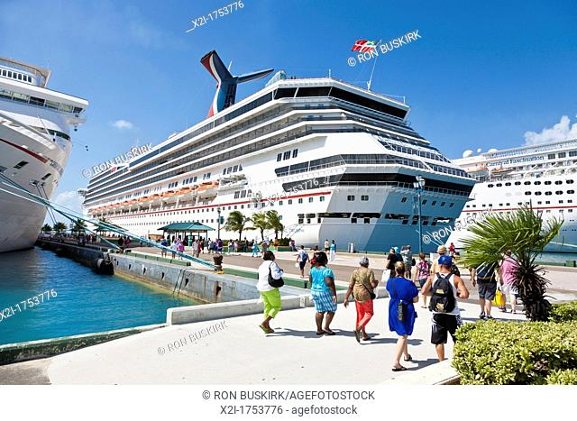 Cruise ship passengers going to and from cruise ships at dock in Nassau, Bahamas