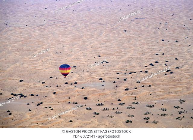 Ballon in the desert. Dubai Desert Conservation Reserve. Aerial view, Dubai, United Arab Emirates