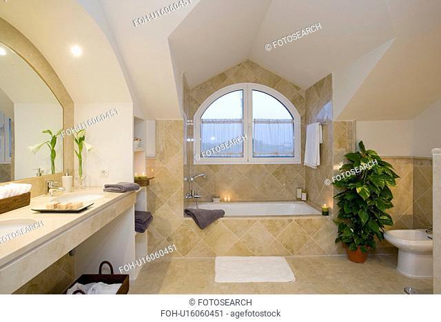 Unuual curved dormer window in attic bathroom