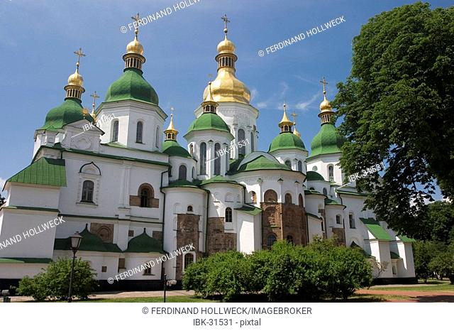 Ukraine Kiev Sophien cathedral 1054 the 13 domes of the cathedral historical building golden domes and crosses shines in the sun monastery garden trees and...