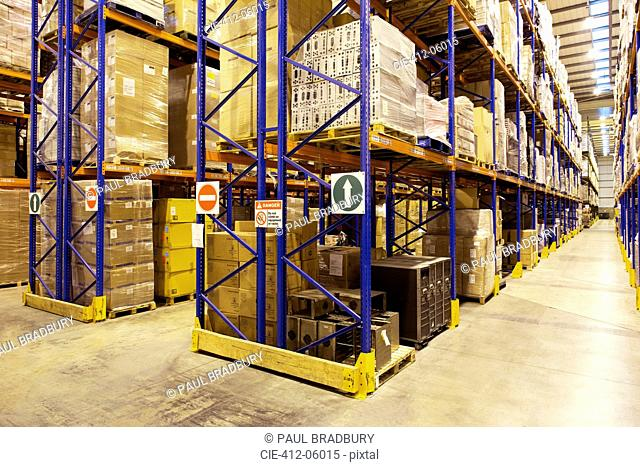 Aisles of boxes in warehouse
