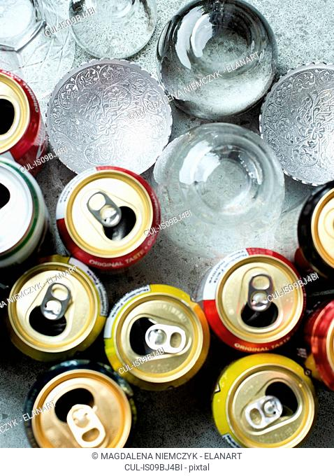 Open drinks cans and glasses, overhead view