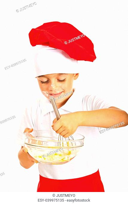 Smiling chef boy mixing dough isolated on white background