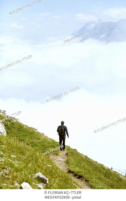 Austria, South Tyrol, hiker on hiking trail