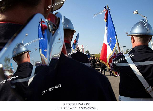 FIREFIGHTER WITH THE FRENCH FLAG AND THE FIREFIGHTER'S AXE, NATIONAL CONGRESS OF FRENCH FIREFIGHTERS, AVIGNON (84), FRANCE