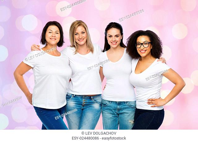 friendship, diverse, body positive and people concept - group of happy different size women in white t-shirts hugging over rose quartz and serenity holidays...