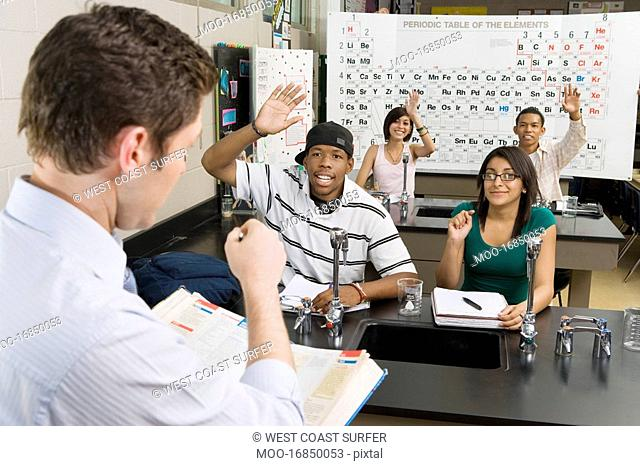 Teacher Calling on Student in Science Class