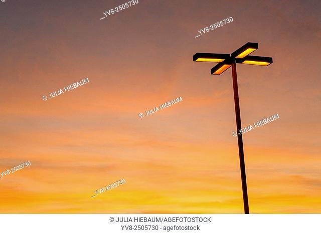 Light pole glowing at dusk, San Diego, California