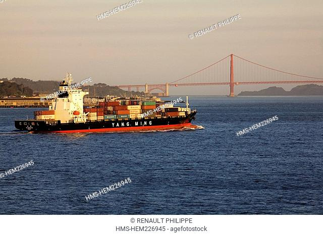 United States, California, San Francisco merchant ship container carriers in the bay and Golden Gate Bridge in the background