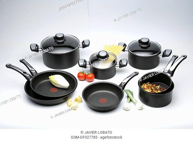 Nonstick kitchenware still life on white background with products inside