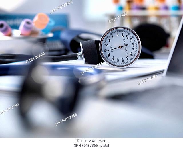 Blood pressure gauge, stethoscope and human samples awaiting medical testing
