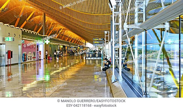 Interior corridor of the hall of terminal T4 of the Adolfo Suarez airport in Madrid, Spain
