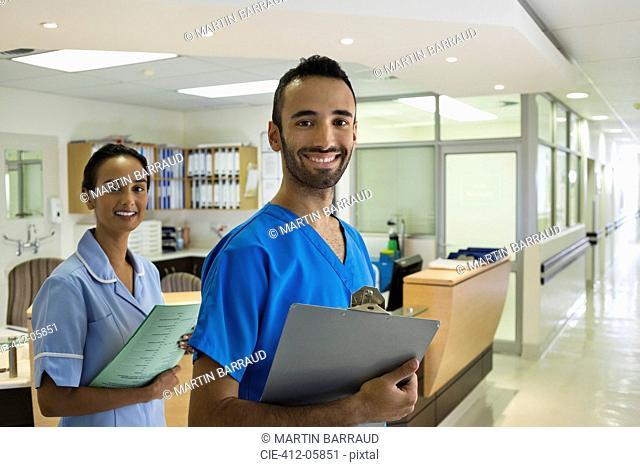 Nurses smiling in hospital hallway