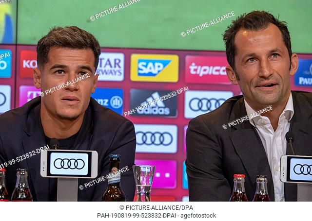 19 August 2019, Bavaria, Munich: Philippe Coutinho (l) and Hasan Salihamidzic, sports director of FC Bayern Munich, take part in the press conference for the...