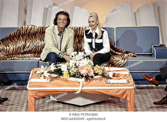 Raffaella Carrà with Christian De Sica in 40 minuti con Raffaella. Italian TV host, actress, singer and showgirl Raffaella Carrà (Raffaella Maria Roberta...