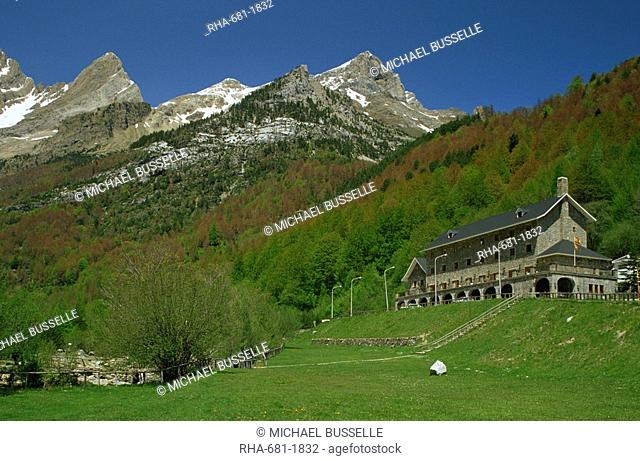 The Parador of Bielsa with snow capped mountains behind, in Aragon, Spain, Europe