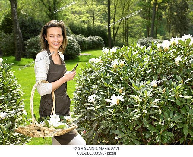 Woman gardening outdoors smiling