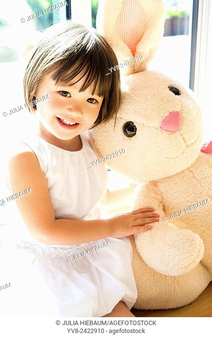 Sweet toddler girl with her Easter bunny