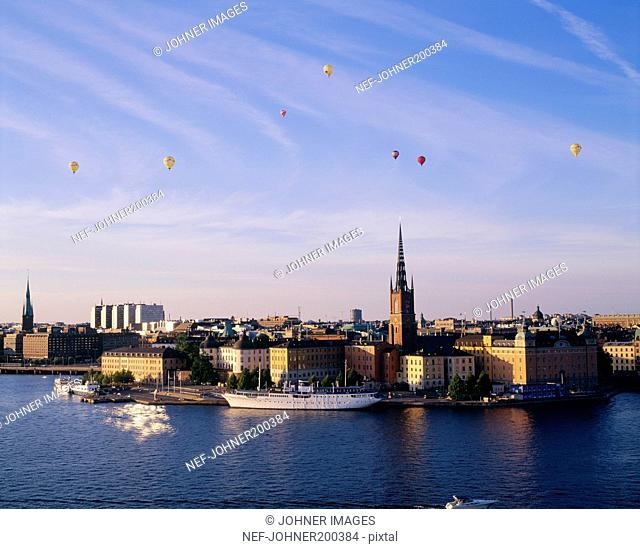 Parachute flying with cityscape