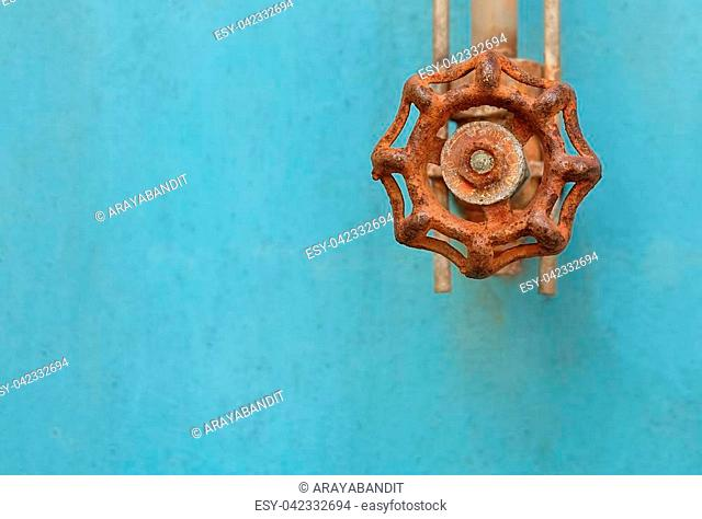Rusted Valve and Pipe with Old Glass Tube on The Blue Metal Grunge Boiler Machine