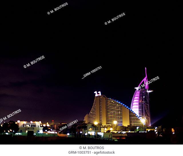 Burj Al Arab and Jumeirah Beach Hotel at night, Dubai, UAE