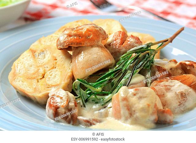 Porcini mushrooms in cream sauce served with bread dumplings