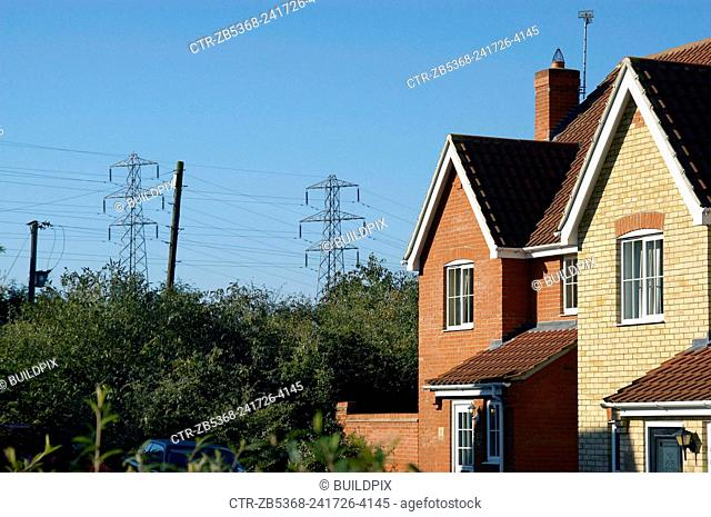 Houses with Electric pylon, England