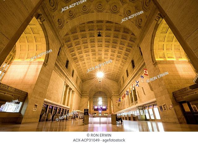 The Grand Hall in Toronto Union Station in downtown Toronto, Ontario, Canada has a coffered vault ceiling of Gustavino tiles and a marble herringbone patterned...