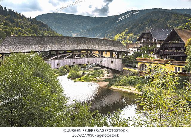 historical wooden covered bridge over the river Murg, landmark of village Forbach, Northern Black Forest, Murg valley