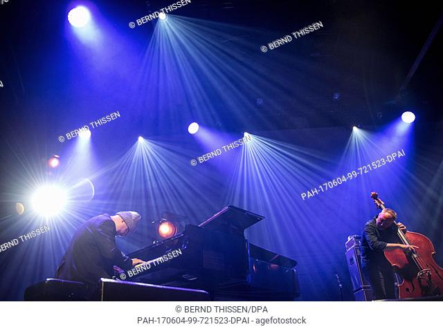 Pianist Ethan Iverson (l) and bassist Reid Anderson of the alternative jazz trio The Bad Plus perform on stage during the Moers Festival in Moers, Germany