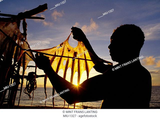 Vezo fisherman drying squid, Western Madagascar