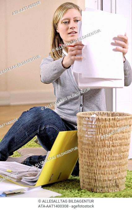 Woman muck out papers
