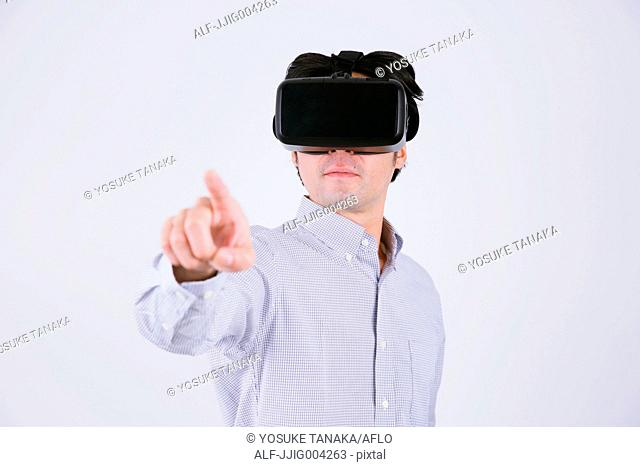 Japanese man using virtual reality device