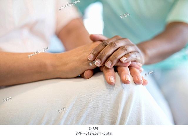 Nurse reassuring patient