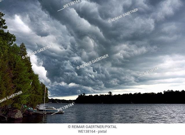 Early stages of dark clouds before a thunderstorm over Lake Cecebe in cottage country of Magnetawan Ontario