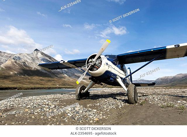 Bushplane arriving at the Noatak River, Brooks Range, Arctic Alaska; Alaska, United States of America
